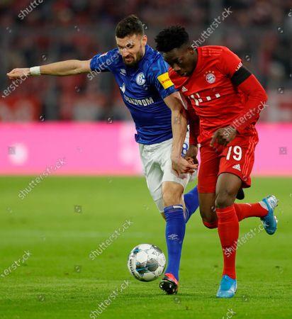 Alphonso Davies of Bayern (R) in action against Daniel Caligiuri of Schalke (L) during the German Bundesliga soccer match between FC Bayern Munich and FC Schalke 04 in Munich, Germany, 25 January 2020.