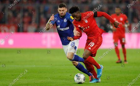 Daniel Caligiuri of Schalke (L) in action against Alphonso Davies of Bayern (R) during the German Bundesliga soccer match between FC Bayern Munich and FC Schalke 04 in Munich, Germany, 25 January 2020.