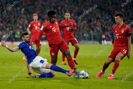 Daniel Caligiuri of Schalke (L) in action against Alphonso Davies of Bayern (C) and Ivan Perisic of Bayern (R) during the German Bundesliga soccer match between FC Bayern Munich and FC Schalke 04 in Munich, Germany, 25 January 2020.