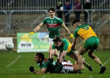 Donegal vs Mayo. Donegal's Michael Langan and Peadar Mogan and Mayo's Aidan O'Shea