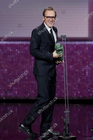 Stock Image of Alberto Iglesias wins the Best Original Music award for his work on 'Dolor y Gloria' (Pain and Glory) during the 34th Goya Awards ceremony held at the Jose Maria Martin Carpena Sports Palace in Malaga, Spain, 25 January 2020. The awards are presented by the Spanish Film Academy.
