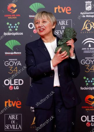 Stock Photo of Spanish editor Teresa Font wins the Best Edition award for her work on 'Dolor y Gloria' (Pain and Glory) during the 34th Goya Awards ceremony held at the Jose Maria Martin Carpena Sports Palace in Malaga, Spain, 25 January 2020. The awards are presented by the Spanish Film Academy.