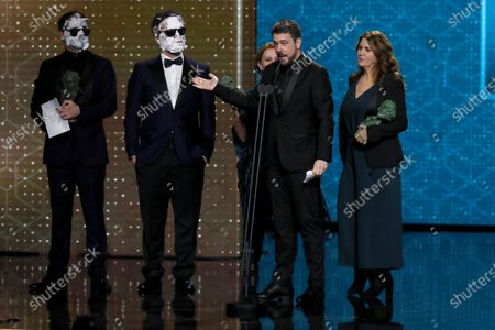"""The winners of the """"Best makeup and hairdressing"""" award, Nacho Diaz, Ana Lopez (R) and Belen Lopez, for their work on """"While the war lasts"""" during the 34th Goya Awards ceremony held at the Jose Maria Martin Carpena Sports Palace in Malaga, southern Spain, 25 January 2020. The awards are presented by the Spanish Film Academy."""