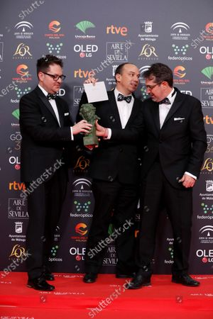 """Stock Image of The creators Jose Luis Quiros, Paco Saez and Nicolas Matji after receiving the Goya for the """"Best Animated Short Film"""" for their work """"Madrid 2120"""" during the 34th Goya Awards ceremony held at the Jose Maria Martin Carpena Sports Palace in Malaga, southern Spain, 25 January 2020. The awards are presented by the Spanish Film Academy."""