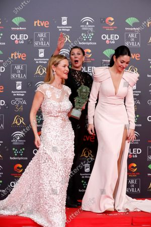 The daughters of Pepa Flores 'Marisol',  Maria Esteve, Tamara Gades and Celia Flores, with the 'Goya of honor' on behalf of their mother, during the 34th Goya Awards ceremony held at the Jose Maria Martin Carpena Sports Palace in Malaga, southern Spain, 25 January 2020. The awards are presented by the Spanish Film Academy.