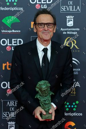 """Alberto Iglesias poses with his trophy after wining the best original music award for """"Dolor y gloria"""" during the Goya Film Awards Ceremony in Malaga, southern Spain, . The annual Goya Awards are Spain's main national film awards"""