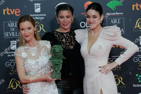 """Maria Esteve, Tamara Gades, Celia Flores. Spanish actress Maria Esteve, Tamara Gades and Spanish singer Celia Flores, from left, pose with the honorific Goya trophy awarded to Spanish actress Pepa Flores """"Marisol"""" during the Goya Film Awards Ceremony in Malaga, southern Spain, early . The annual Goya Awards are Spain's main national film awards"""