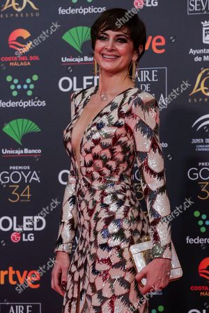 Stock Picture of Spanish actress Cuca Escribano poses for photographers at the red carpet ahead the Goya Film Awards Ceremony in Malaga, southern Spain,. The annual Goya Awards are Spain's main national film awards