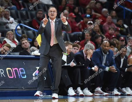 Oklahoma head coach Lon Kruger gives instructions to his team during the first half of an NCAA college basketball game in Oklahoma City