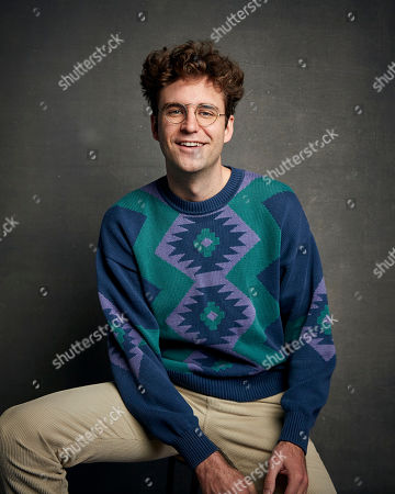 """Stock Photo of John Reynolds poses for a portrait to promote the film """"Save Yourselves!"""" at the Music Lodge during the Sundance Film Festival, in Park City, Utah"""