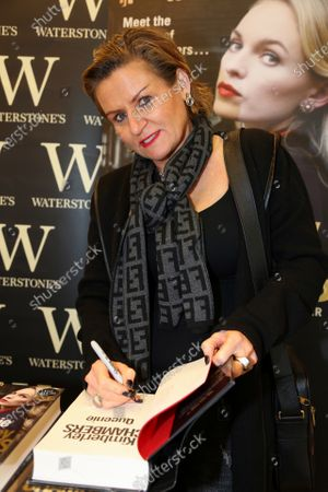 Stock Photo of Kimberley Chambers signs copies of her book at Waterstones bookshop in Romford