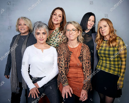 """Stock Picture of Gina Schock, Belinda Carlisle, Kathy Valentine, Charlotte Caffey, Jane Wiedlin, Alison Ellwood. Gina Schock, from back left, Belinda Carlisle, Kathy Valentine, and Charlotte Caffey, and from bottom left, Jane Wiedlin, and director Alison Ellwood pose for a portrait to promote the film """"The Go-Go's"""" at the Music Lodge during the Sundance Film Festival, in Park City, Utah"""