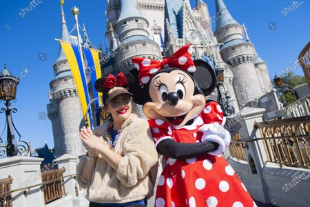 Stock Image of Drew Barrymore strikes a pose with Minnie Mouse