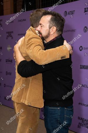 """Paul Bettany, Alan Ball. From left, actor Paul Bettany and director/writer/producer Alan Ball embrace during the premiere of """"Uncle Frank"""" at the Eccles Theatre during the 2020 Sundance Film Festival, in Park City, Utah"""