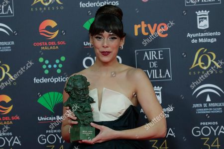 "Belen Cuesta poses with her trophy after wining the best leading actress award for ""La trinchera infinita"" during the Goya Film Awards Ceremony in Malaga, southern Spain, early . The annual Goya Awards are Spain's main national film awards"