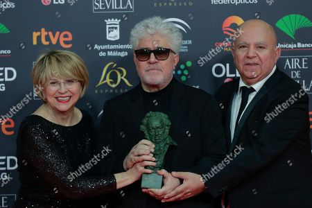"Pedro Almodovar, Agustin Almodovar, Esther Garcia. Spanish film director Pedro Almodovar, center, and producers Agustin Almodovar and Esther Garcia, left, pose with their trophy after winning the best film award for ""Dolor y gloria"" during the Goya Film Awards Ceremony in Malaga, southern Spain, early . The annual Goya Awards are Spain's main national film awards"