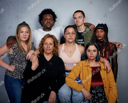 """Jackie Corin, Alex King, David Hogg, Kim A. Snyder, Emma Gonzalez, Sam Fuentes, Bria Smith. Jackie Corin from top left, Alex King, David Hogg, director Kim A. Snyder, from bottom left, Emma Gonzalez, Sam Fuentes and Bria Smith pose for a portrait to promote the film """"Us Kids"""" at the Music Lodge during the Sundance Film Festival, in Park City, Utah"""