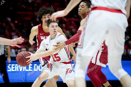 Utah guard Rylan Jones (15) looks to pass the ball out while guarded by Washington State guard Jervae Robinson, right, and Washington State forward CJ Elleby, back, in the first half during an NCAA college basketball game, in Salt Lake City