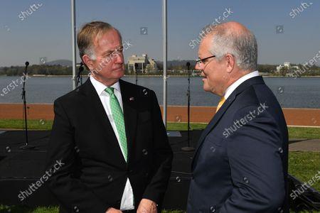 US Ambassador to Australia Arthur B. Culvahouse Jr. (L) and Australian Prime Minister Scott Morrison (R) converse during an Australia Day Citizenship Ceremony and Flag Raising event in Canberra, Australia, 26 January 2020.