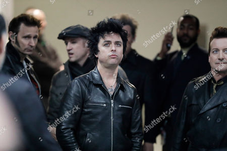 Billie Joe Armstrong, center, and the group Green Day wait to perform between NHL hockey All Star games, in St. Louis