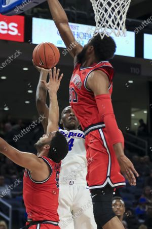 Saturday  - DePaul Blue Demons forward Paul Reed (4) puts up a contested shot during the NCAA game between the St Johns Red Storm and the DePaul University Blue Demons at Wintrust Arena in Chicago IL. Gary E
