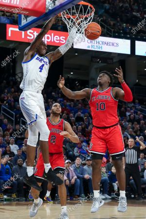 Saturday  - DePaul Blue Demons forward Paul Reed (4) attempts a dunk during the NCAA game between the St Johns Red Storm and the DePaul University Blue Demons at Wintrust Arena in Chicago IL. Gary E