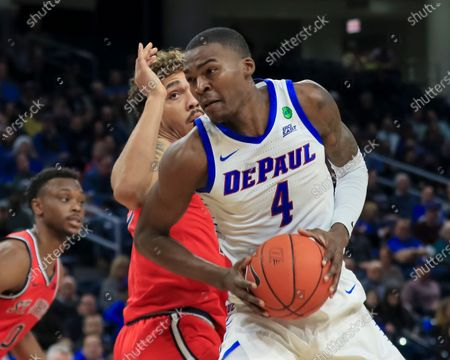 Stock Image of Saturday  - DePaul Blue Demons forward Paul Reed (4) makes a move to the basket during the NCAA game between the St Johns Red Storm and the DePaul University Blue Demons at Wintrust Arena in Chicago IL. Gary E