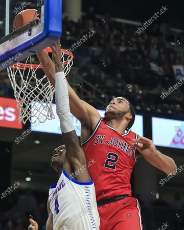 Saturday  - St. John's Red Storm guard Julian Champagnie (2) blocks a shot by DePaul Blue Demons forward Paul Reed (4) during the NCAA game between the St Johns Red Storm and the DePaul University Blue Demons at Wintrust Arena in Chicago IL. Gary E