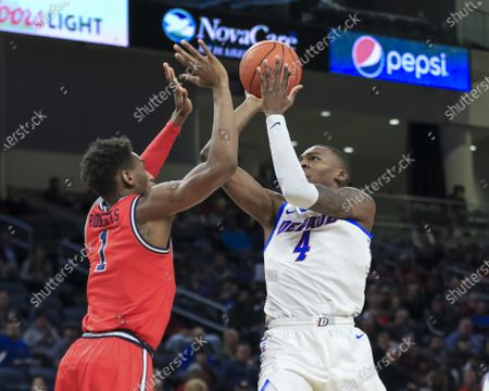 Stock Photo of Saturday  - DePaul Blue Demons forward Paul Reed (4) puts up a shot during the NCAA game between the St Johns Red Storm and the DePaul University Blue Demons at Wintrust Arena in Chicago IL. Gary E