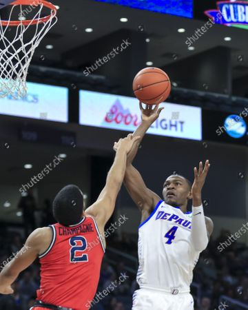 Stock Picture of Saturday  - DePaul Blue Demons forward Paul Reed (4) puts up a shot during the NCAA game between the St Johns Red Storm and the DePaul University Blue Demons at Wintrust Arena in Chicago IL. Gary E