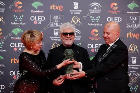 Stock Picture of Pedro Almodovar (C) and producers Agustin Almodovar (R) and Esther Garcia (L) pose with their award for Best Movie for 'Pain and Glory' during the 34th Goya Awards ceremony held at the Jose Maria Martin Carpena Sports Palace in Malaga, Spain, 25 January 2020. The awards are presented by the Spanish Film Academy.