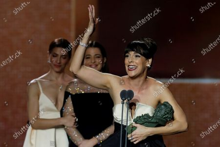 Belen Cuesta (R) receives the award for 'Best main actress' for her work in 'La Trinchera Infinita' (The Endless Trench) during the 34th Goya Awards ceremony held at the Jose Maria Martin Carpena Sports Palace in Malaga, Spain, 25 January 2020. The awards are presented by the Spanish Film Academy.
