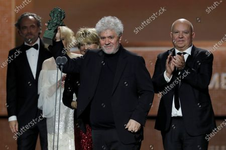 Pedro Almodovar (C) and producers Agustin Almodovar (R) and Esther Garcia (3-R) receive the award for Best Movie for 'Pain and Glory' during the 34th Goya Awards ceremony held at the Jose Maria Martin Carpena Sports Palace in Malaga, Spain, 25 January 2020. The awards are presented by the Spanish Film Academy.