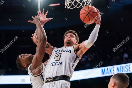 Georgia Tech guard Jordan Usher (4) rebounds the ball over teammate Moses Wright (5) in the first half of an NCAA college basketball game, in Atlanta. Georgia Tech won 64-58