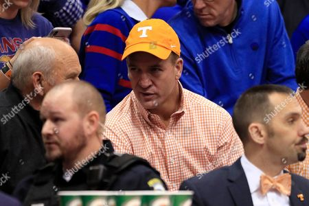 Peyton Manning during the first half of an NCAA college basketball game between Kansas and Tennessee in Lawrence, Kan