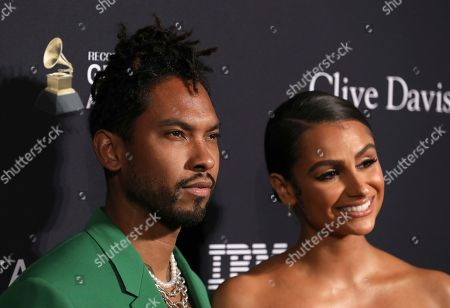Miguel, Nazanin Mandi. Miguel, left, and Nazanin Mandi arrive at the Pre-Grammy Gala And Salute To Industry Icons at the Beverly Hilton Hotel, in Beverly Hills, Calif
