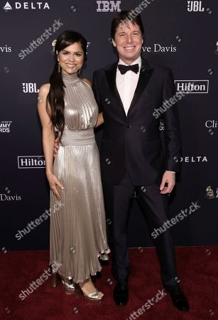 Larisa Martinez, Joshua Bell. Larisa Martinez, left, and Joshua Bell arrive at the Pre-Grammy Gala And Salute To Industry Icons at the Beverly Hilton Hotel, in Beverly Hills, Calif