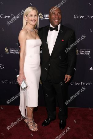 Jennifer Lucas, Byron Allen. Jennifer Lucas, left, and Byron Allen arrive at the Pre-Grammy Gala And Salute To Industry Icons at the Beverly Hilton Hotel, in Beverly Hills, Calif