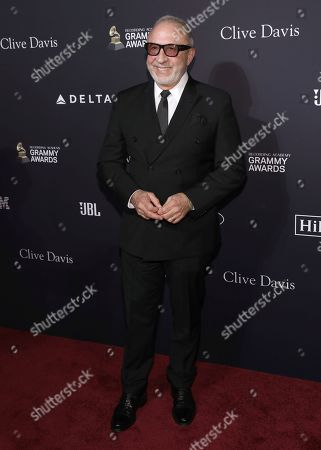 Emilio Estefan arrives at the Pre-Grammy Gala And Salute To Industry Icons at the Beverly Hilton Hotel, in Beverly Hills, Calif