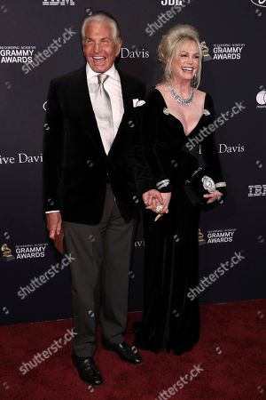 Stock Photo of George Hamilton, Alana Stewart. George Hamilton, left, and Alana Stewart arrive at the Pre-Grammy Gala And Salute To Industry Icons at the Beverly Hilton Hotel, in Beverly Hills, Calif