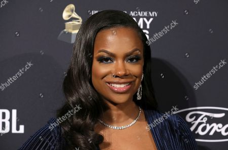 Stock Picture of Kandi Burruss arrives at the Pre-Grammy Gala And Salute To Industry Icons at the Beverly Hilton Hotel, in Beverly Hills, Calif