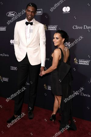 Chris Bosh, Adrienne Bosh. Chris Bosh, left, and Adrienne Bosh arrive at the Pre-Grammy Gala And Salute To Industry Icons at the Beverly Hilton Hotel, in Beverly Hills, Calif