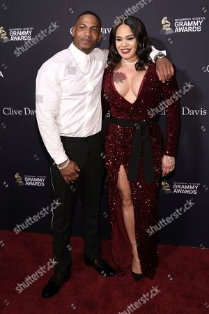 Stevie J, Faith Evans. Stevie J, left, and Faith Evans arrive at the Pre-Grammy Gala And Salute To Industry Icons at the Beverly Hilton Hotel, in Beverly Hills, Calif