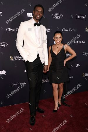 Stock Picture of Chris Bosh, Adrienne Bosh. Chris Bosh, left, and Adrienne Bosh arrive at the Pre-Grammy Gala And Salute To Industry Icons at the Beverly Hilton Hotel, in Beverly Hills, Calif
