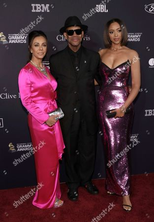 Lisa Padilla, Jimmy Jam, Bella Harris. Lisa Padilla, from left, Jimmy Jam, and Bella Harris arrive at the Pre-Grammy Gala And Salute To Industry Icons at the Beverly Hilton Hotel, in Beverly Hills, Calif