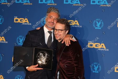Taika Waititi (L) stands with his award for 'Jojo Rabbit' with US actor Sam Rockwell (R) at the 72nd Annual Directors Guild of America (DGA) Awards at the Ritz-Carlton in Los Angeles, California, USA, 25 January 2020.