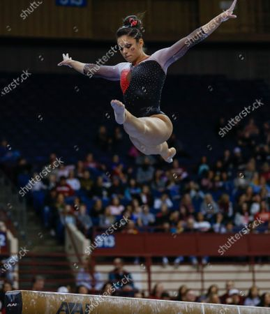 Stock Image of Georgia gymnast Sabrina Vega leaps in the air on the balance beam during the Metroplex Challenge at the Fort Worth Convention Center in Fort Worth, TX