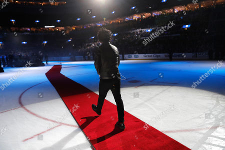Stock Picture of Billie Joe Armstrong of Green Day walks across the ice to perform between NHL hockey All Star games, in St. Louis