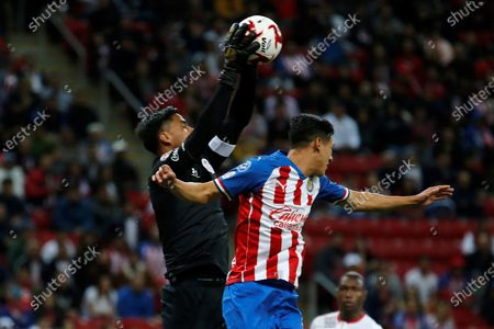 Stock Photo of Chivas' Carlos Antuna (R) in action against Toluca's goalkeeper Alfredo Talavera (L) during a game of the Mexican Tournament, at the Akron Stadium in Guadalajara, Mexico, 25 January 2020.