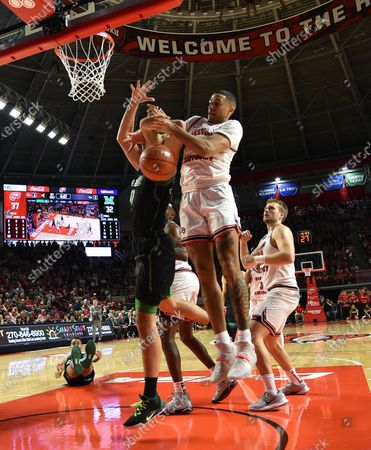 Stock Image of Western Kentucky Hilltoppers guard Jared Savage (2) and Marshall Thundering Herd guard Andrew Taylor (0) fight for the rebound during a NCAA basketball game between the Marshall Thundering Herd and the WKU Hilltoppers at E.A. Diddle Arena in Bowling Green, KY (Photo Credit: Steve Roberts.CSM)